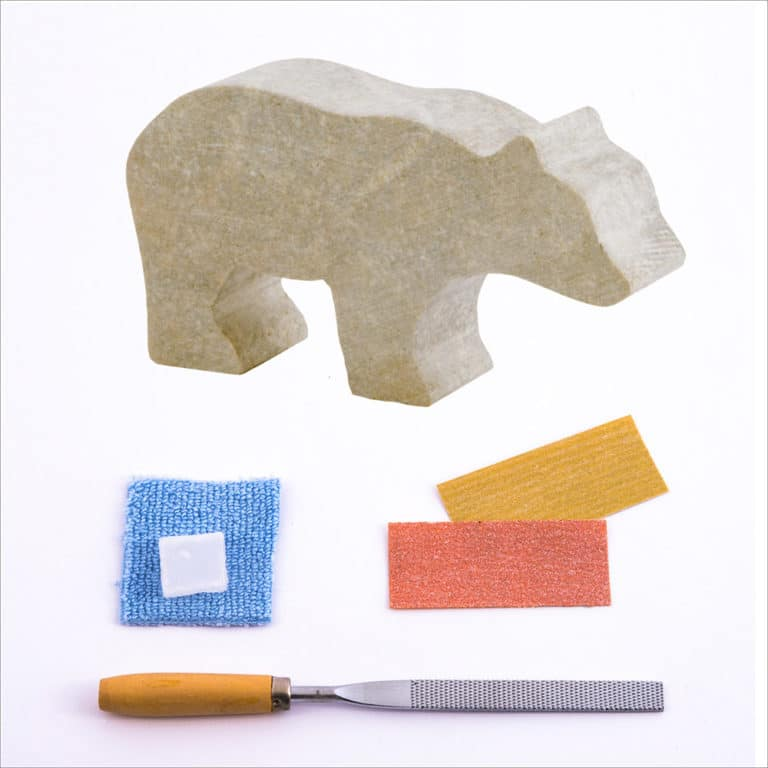 Pre-cut bear stone, carving file, sandpapers, polishing wax, buffing cloth