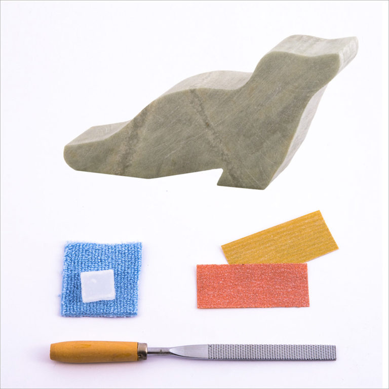 Pre-cut seal stone, carving file, sandpapers, polishing wax, buffing cloth