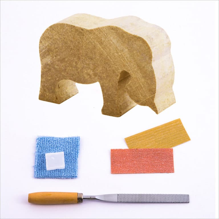 Pre-cut elephant stone, carving file, sandpapers, polishing wax, buffing cloth