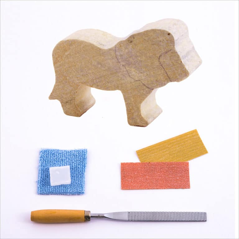 Pre-cut lion stone, carving file, sandpapers, polishing wax, buffing cloth