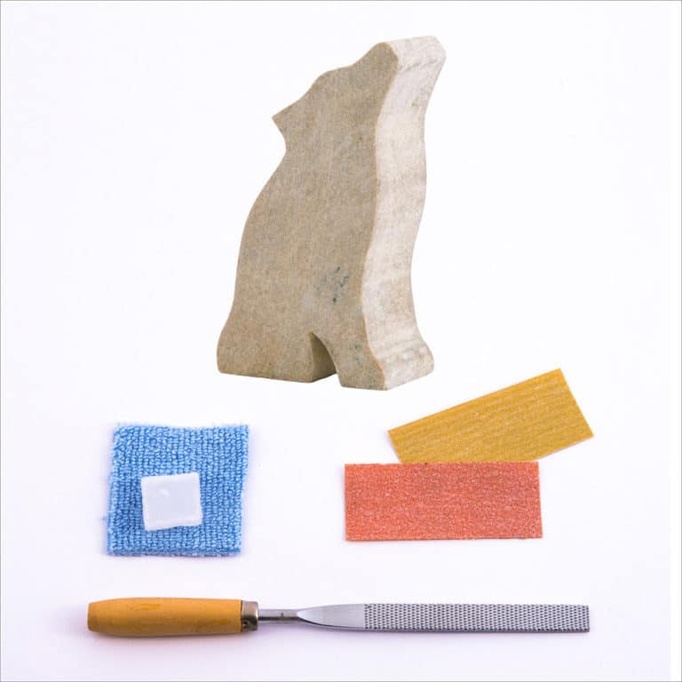 Pre-cut wolf stone, carving file, sandpapers, polishing wax, buffing cloth