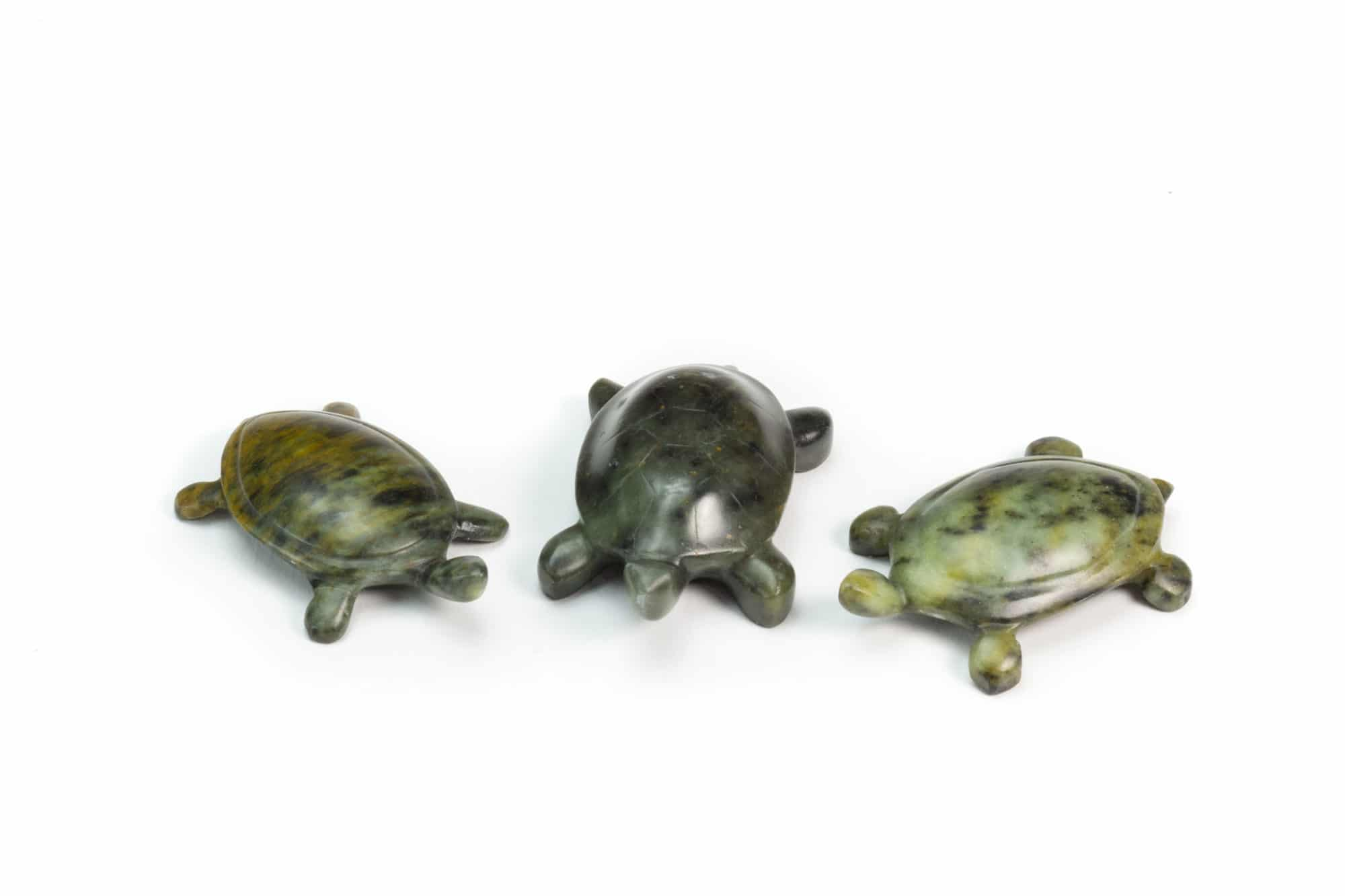 Three turtles carved from a soapstone