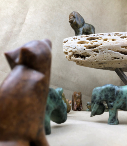 Lion king scene with animals carved from soapstone