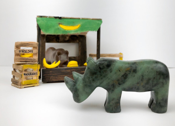 Two rhino made from soapstone, one is in a banana stand