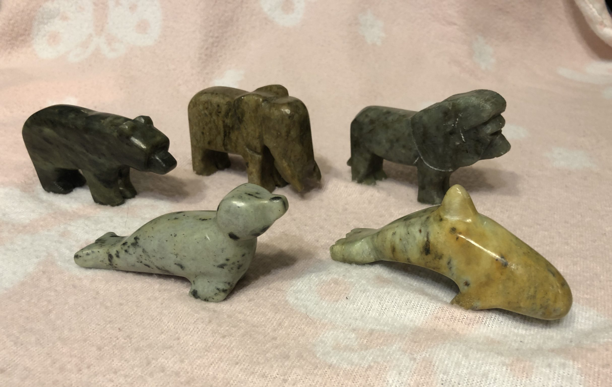 Seal, bear, elephant, lion and orca carved from a soapstone